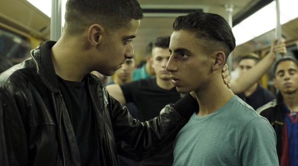 Aboubakr Bensaihi (right) as Marwan with his older brother Nassim (Soufiane Chilah)
