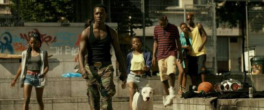 The 'Black Bronx' led by 'X' (centre with his dog)
