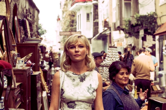 Press Photo of Kirsten Dunst in a street market from Magnolia Pictures.