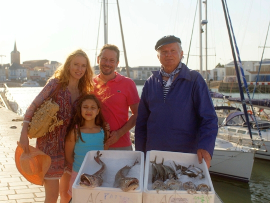 Julien with his wife Delphine and daughter Suzanne on holiday