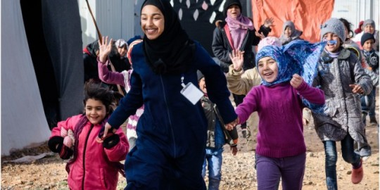 Layla as play-leader in a refugee camp
