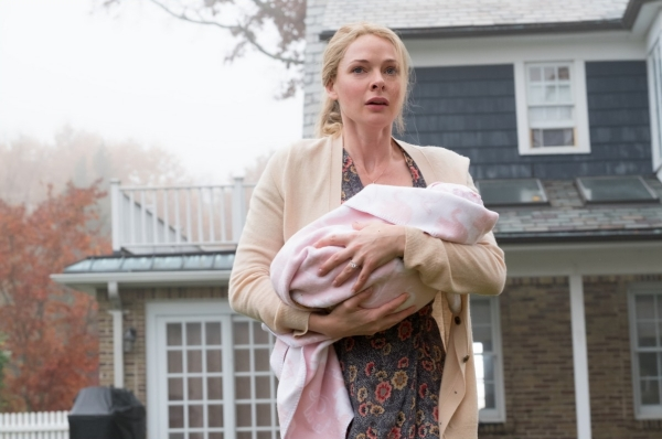 "Anna (Rebecca Ferguson) with her baby, Evie – trapped in the town which is a ""baby-making factory""?"