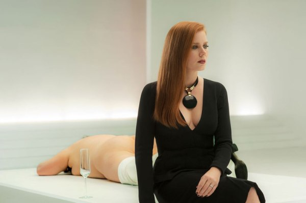 Still life? Amy Adams as Susan seems like a statue in her art gallery, posed at the opening of her new exhibition next to one of the naked women hired to act as exhibits.