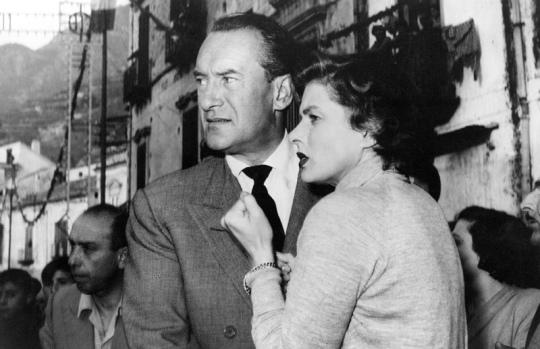 Alex (George Sandrs) and Katherine (Ingrid Bergman) are disturbed by the crowds at a religious festival in 'Viaggio in Italia'