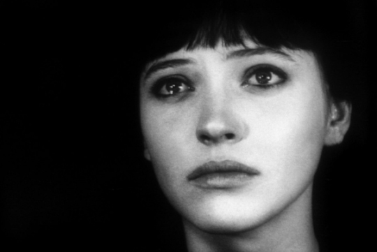 Anna Karina as 'Nana', visibly upset while watching Dreyer's Jeanne d'Arc on a cinema visit in 'Vivre sa vie'