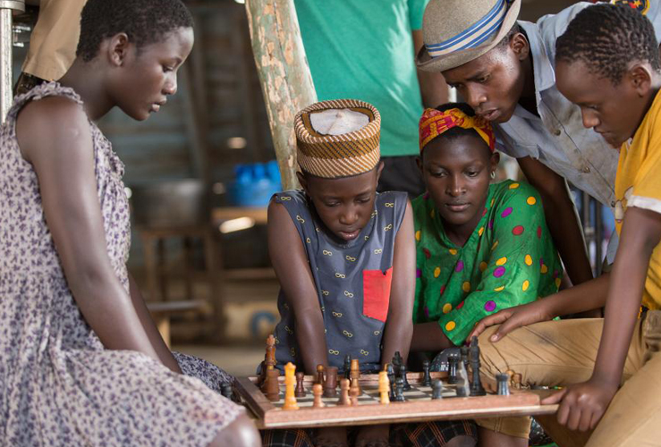 The Katwe children at the chessboard