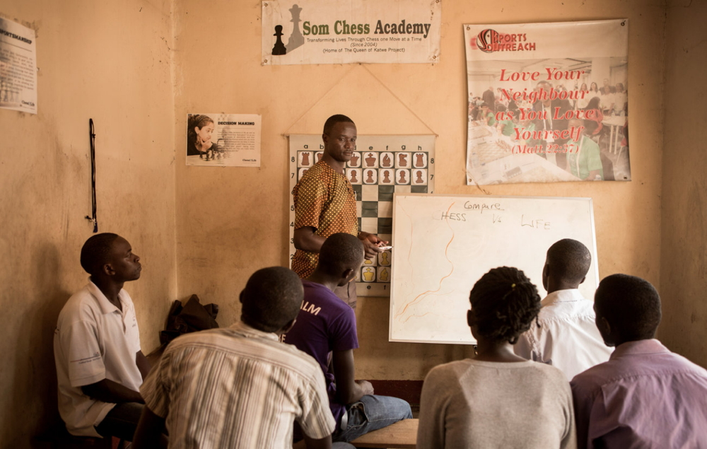 Robert Katende teaches a class at the Katwe Chess Academy, which he founded in 2003. Martina Bacigalupo for NPR (http://www.npr.org/sections/goatsandsoda/2016/10/05/496425623/photos-theyre-all-kings-and-queens-of-katwe)