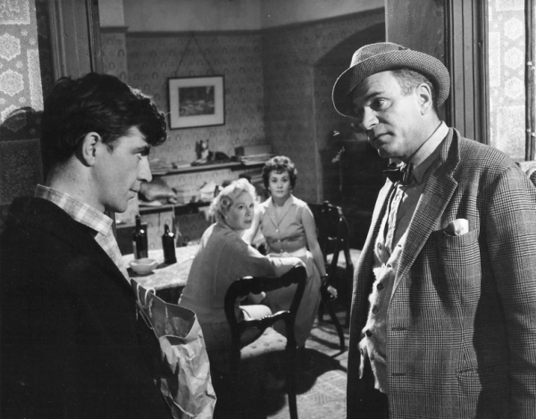 An in-depth composition (looking very much like a stage play) with Frank (Alan Bates) and Archie (Laurence Olivier) in the and (Phoebe) Brenda de Banzie and Jean (Joan Plowright) in the background.