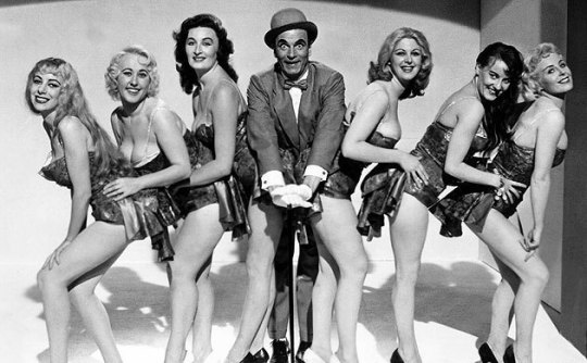 Archie and his dancers, the film suggests that the women are more scantily clad than it was possible to show on screen – thus the suggestion of sleaze