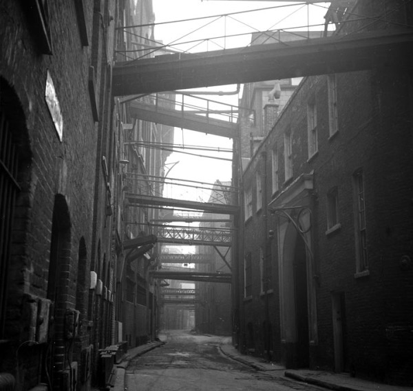 The noirish mise en scène readily available on location among the warehouses of the Port of London