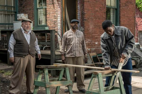 Creating a metaphor in FENCES. From the left, Stephen Henderson as Jim Bono, Denzel Washington as Troy Maxson and Joyvan Adepo as Cory